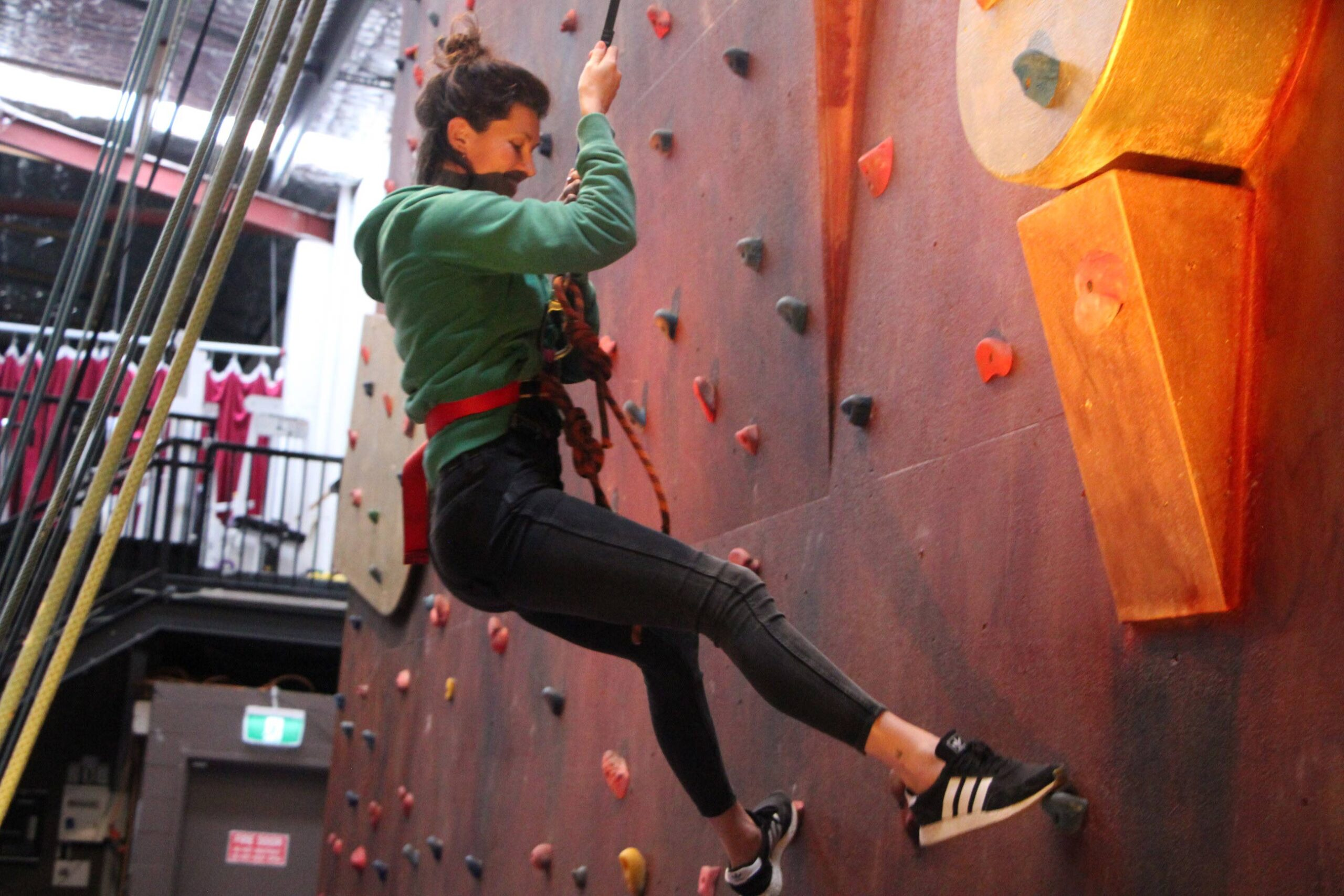 Adult on the climbing wall in Byron Bay Circus Arts