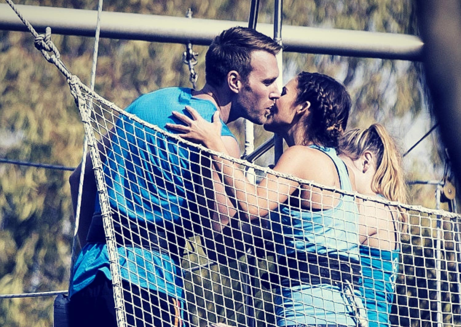 Kissing on the flying trapeze board Sydney