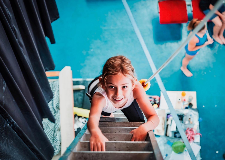 Child climbing ladder Circus Arts Byron Bay