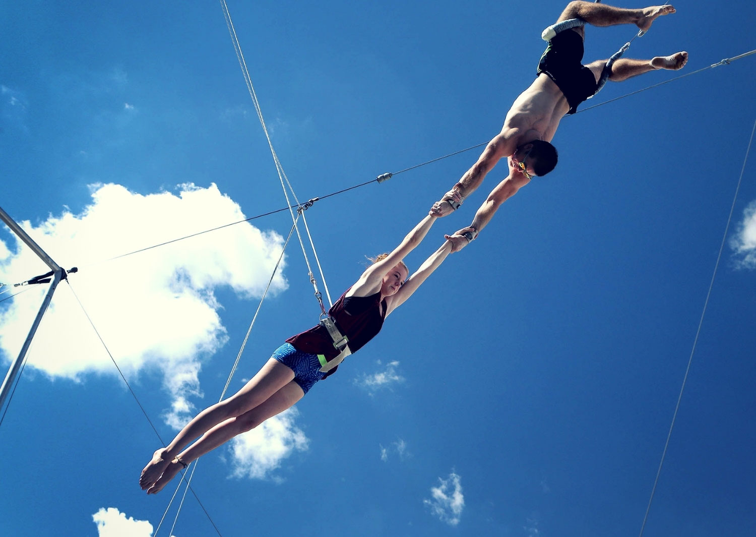 Outdoor flying trapeze catch in safety lines Circus Arts Sydney
